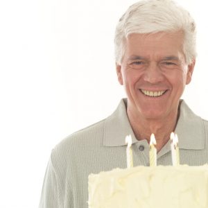 Middle-aged Man with Birthday Cake