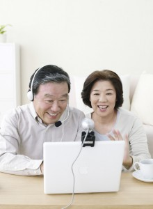 Older Couple Using Webcam --- Image by © Royalty-Free/Corbis