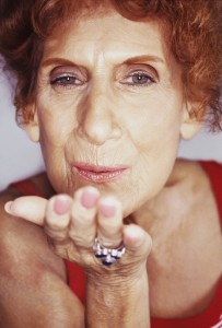 2001 --- Senior Woman Blowing Kisses --- Image by © Royalty-Free/Corbis